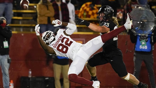 Iowa State linebacker Mike Rose breaks up a pass intended for Oklahoma wide receiver Obi Obialo during Saturday's 37-30 Cyclones victory in Ames, Iowa. The Sooners have opened Big 12 play with back-to-back losses.