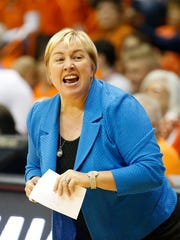 UTEP head coach Keitha Adams calls out a play to her