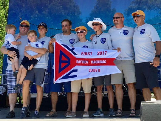 The crew of Good Lookin' with the first-place burgee for Class D: Jimmy Irland, left, Kevin Irland, Charlie Irland, Brennan Churchill, Mark DenUyl, Brock DenUyl, Bryson DenUyl, Ron Churchill and John Anter.
