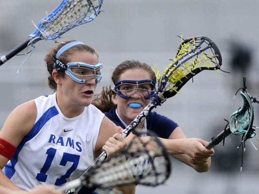 Manheim Township's Katherine Torrance defends against Kennard-Dale's Lyndsey Duty during the PIAA District 3 championship lacrosse game in Hershey during May, 2013. Kennard-Dale lost to Manheim Township, 14-10.