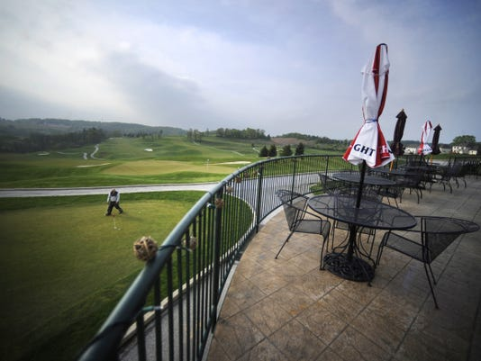 The deck at Bogey Macaws boasts a beautiful view overlooking the golf course.
