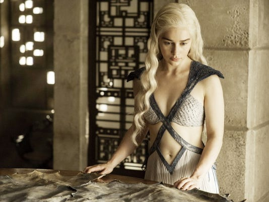 """Daenerys Targaryen, portrayed by Emilia Clarke, appears in a scene from season four of """"Game of Thrones."""" The fifth season premiered Sunday."""
