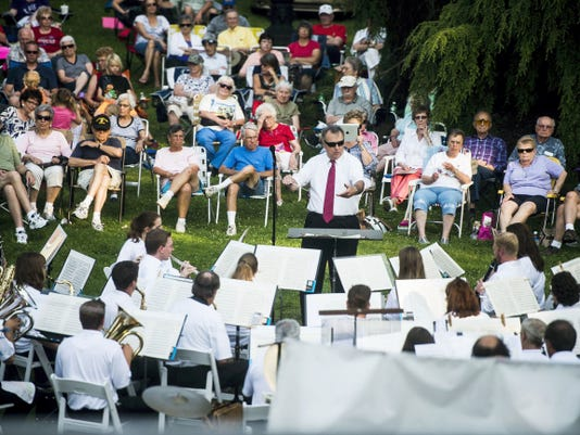 Director Galen Leitzel leads the Lyric Band of Hanover in a musical selection themed for the Fourth of July during Lawn Concerts at the Mansion on Wednesday night June 1, 2015 at the Warehime-Myers Mansion on Baltimore Street. The Hanover concert series by the Hanover Area Historical Society continues every first Wednesday of the month. In August the JazzBerries will perform and in September the Gettysburg Big Band will entertain crowds.  Shane Dunlap - The Evening Sun