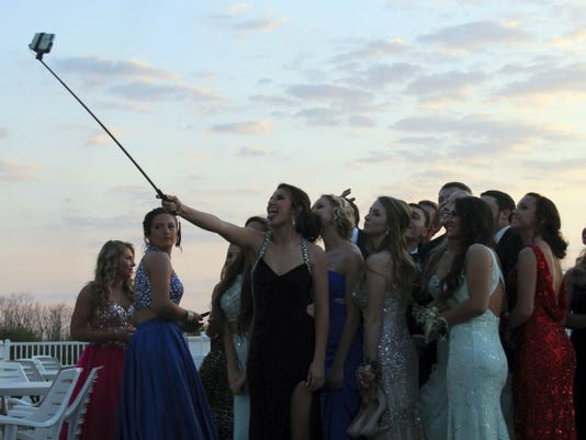 Students use a selfie stick to take a big group picture at Greencastle-Antrim High School's 2015 prom on May 2 at Green Grove Gardens, Greencastle.