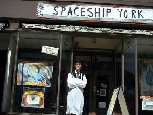 Director and project developer William Chambers poses in front of what was an empty storefront but is now the home of Spaceship York on the first block of West Market Street in York Wednesday. The public is invited to help create and collaborate in the space Monday, Tuesday, and Thursday from 9 a.m. to 2 p.m.,, Friday from 6 to 9 p.m., and Saturday 10 a.m. to 2 p.m.