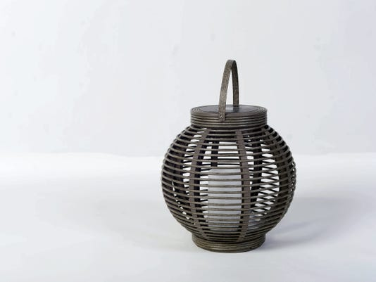 An eco-friendly and virtually risk free lighting solution like this Threshold solar lantern adds a statement without occupying too much room. Photos taken in studio Friday, April 10, 2015.