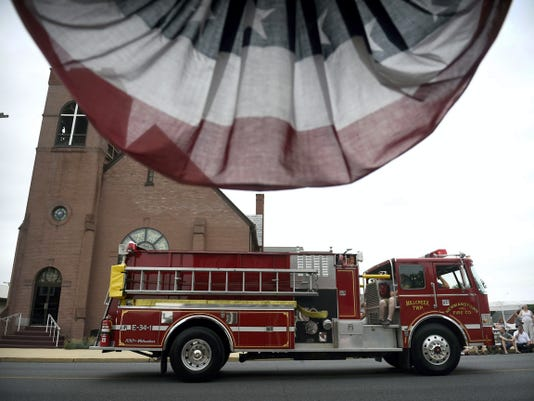 Newmanstown Fire Co. engine inches down Market Street in Jonestown Saturday afternoon for the Lebanon County Firefighters Association convention parade. The convention wrapped up Saturday with a carnival.
