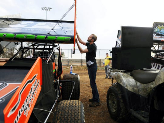 Austin Hogue applies a new decal to his car at Williams Grove Speedway in Mechanicsburg on April 17. Hogue entered Friday night's racing eighth in the Williams Grove points standings and is climbing the ladder in the standings at Lincoln Speedway.