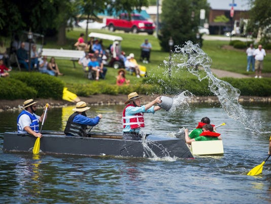 """Contestants compete in the """"last boat floating"""" competition during the annual Cross Keys Village cardboard boat regatta Friday June 6, 2015 at Cross Keys Village.  Shane Dunlap - The Evening Sun"""
