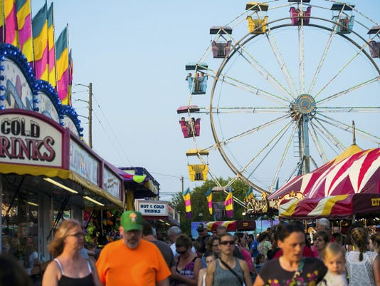 Crowds pack the grounds of the Delone Catholic High School Carnival on June 10.