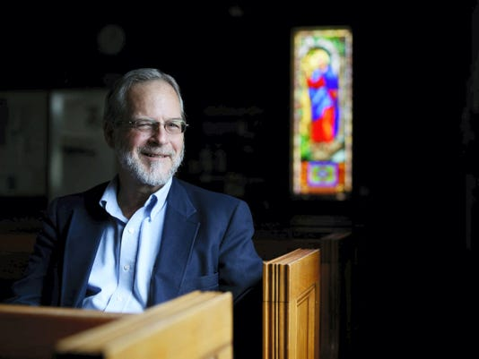 """Pastor Ed Ross poses at the church he has lead for over 21 years, Springwood Chapel, in York Township. Ross recently published a book of poetry """"Glory Wrought"""", on the struggles and joys of faith."""