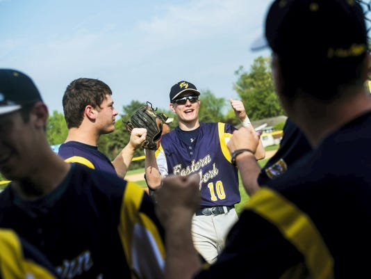 Eastern York players greet outfielder Mitchel Winter at the end of an inning during Eastern's 2-0 victory against Delone Catholic Friday during a YAIAA baseball semifinal at Spring Grove High School.