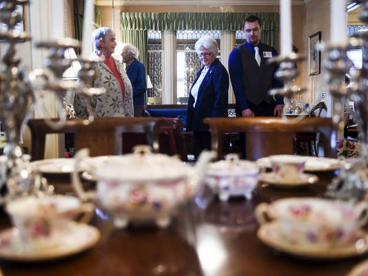Members of the public browse through the former home of Charlotte Sheppard DeVan on Eichelberger Street in Hanover on Friday for a pre-showing of the well-known Hanover family heirlooms. The items were auctioned on Saturday.