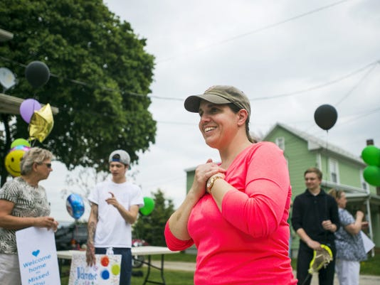 Kelly Keller waits anxiously in front of her McAllister Street home May 7 for the arrival of her son, Jordan, during his homecoming from Magee Rehabilitation Hospital in Philadelphia. Jordan Keller suffered a brain injury in a car crash in November.