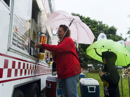 Melissa Braun of Hanover orders a hot dog for her son, Jacob, 6, at the food court section of Codorus Blast in 2014 at Codorus State Park.