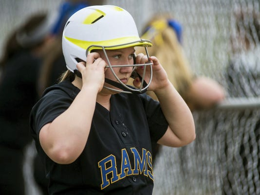 Kennard-Dale's Katelyn Mayle adjusts her helmet as she watches the Rams' April 7 game against Littlestown. Kennard-Dale won the contest, 3-1.