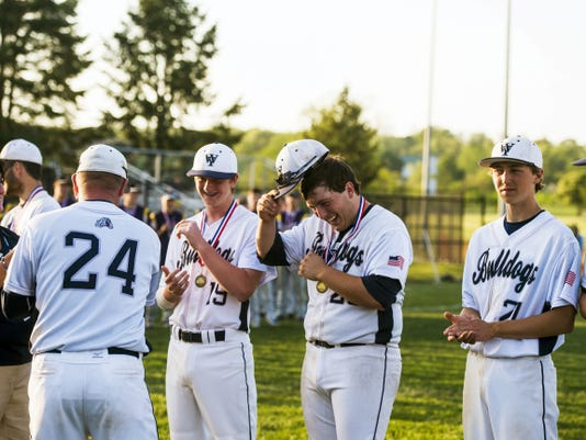 West York's Logan Stover laughs after receiving a medal following the Bulldogs' 3-2 win over Eastern York in the YAIAA championship at Spring Grove High School.