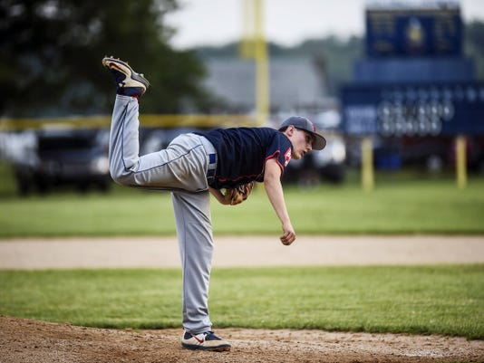 Dallastown's Chris Demarco follows through on his pitch during a June 11 American Legion baseball game against Hanover. Dallastown won the contest, 5-0.