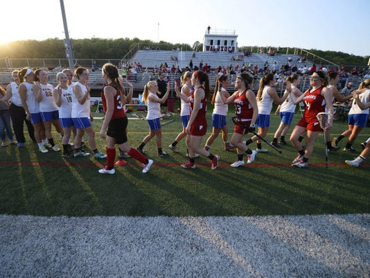 Susquehannock and Kennard-Dale girls high-five after the YAIAA girls' lacrosse championship game May 7. Kennard-Dale won, 14-11.