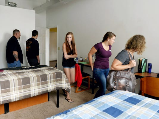 Farrah Horst of Lebanon, center, and Jocelyn Arnold of Jonestown, both rising freshmen at YTI Career Institute's York campus, take a look at a shared bedroom option with Arnold's mother Renee, right, during a tour of the Lofts at Ribbon Place. While many students at YTI Career Institute's York campus are commuters or live in town, the school hosted the tour of area apartment complexes to help out those who are coming from out of town.