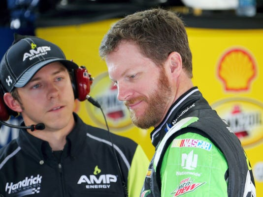 Dale Earnhardt Jr., right, talks with crew chief Greg Ives on Friday after practicing for Sunday's NASCAR Sprint Cup series auto race at Michigan International Speedway in Brooklyn, Mich.