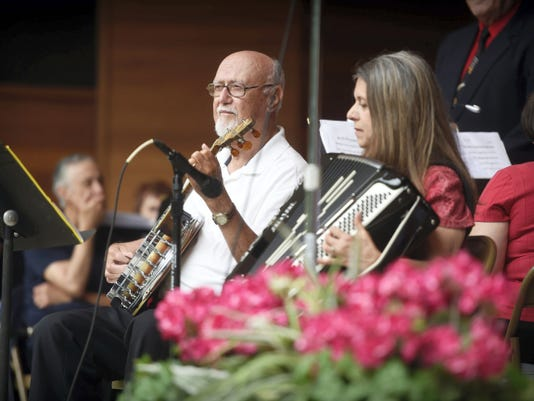 """Carolyn Peiffer Erdman and """"Banjo Bob"""" Balthaser perform during Saturday's Fourth of July community concert at Coleman Memorial Park. Special guest for the event was Bill Messerschmidt, a county native who served in the U.S. Army band."""