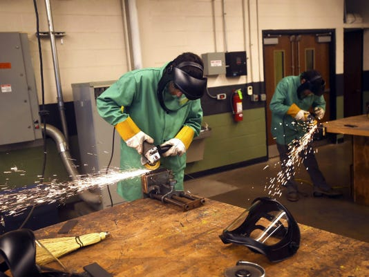 Students learn welding and grinding techniques during a summer program Thursday at James Buchanan High School.
