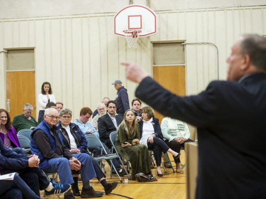 Moderator Sam Giardullo directs a question from the audience assembled at the East Berlin Area Community Center on April 14, 2015. Clare Becker - The Evening Sun