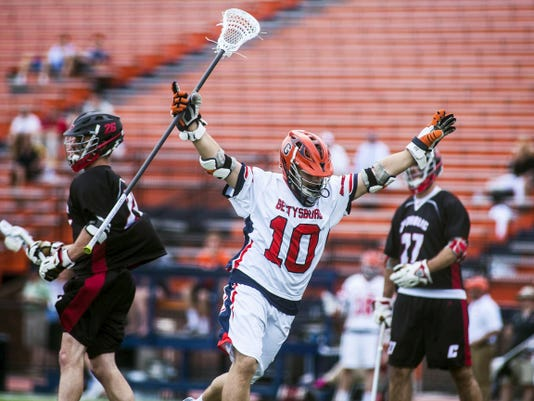Gettysburg's Owen Rothe celebrates after scoring against Catholic University during a first-round NCAA Division III tournament game Wednesday at Gettysburg College. The Bullets defeated the Cardinals, 19-3, to set a school record for wins in a single season (18) and to tie the school record for goals in an NCAA tournament game.