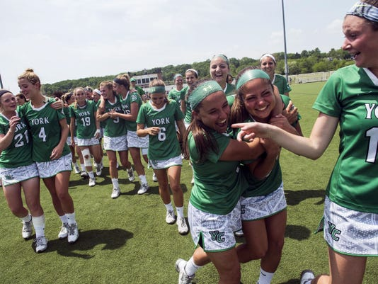 York College players celebrate after their 8-7 victory against Gettysburg College in Saturday's NCAA Division III quarterfinal game at Gettysburg College.