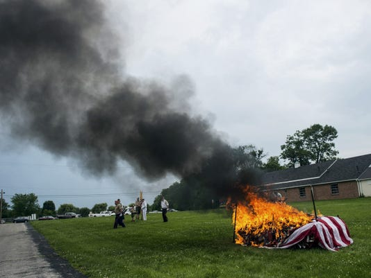 A flag burns during the flag retirement ceremony at the Hanover Elks Lodge 763 on June 14.