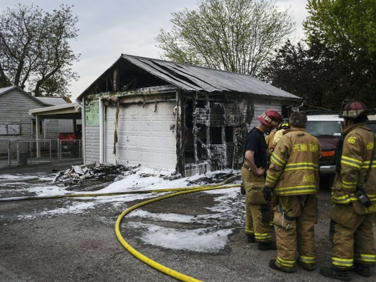 Firefighters work at the scene of a garage fire at 28 West Hanover St. in Hanover on May 5.