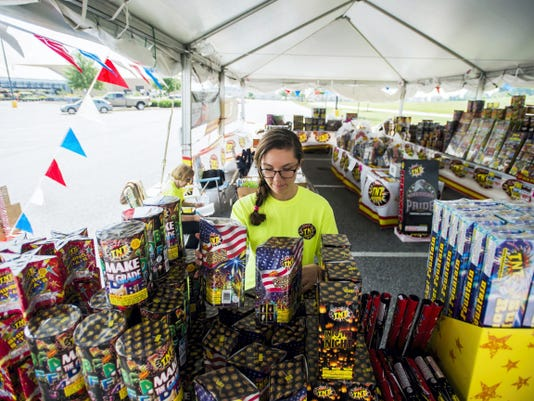 Sarah Kaltreider, of Hanover, organizes displays of fireworks Friday at the vendor tent her family operates at the West Manheim Township Walmart. Kaltreider has operated a TNT Fireworks tent for the second time since beginning in the business last year. Vendors will be selling the fireworks every day from 8 a.m. to 10 p.m. until July 5.
