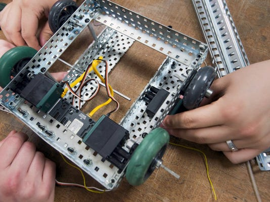 Jedidiah Leiberknecht and Wyatt Love work on a robotic vehicle for Vex Spring Robotics Competition coming up April 11 at Dover Area High School.