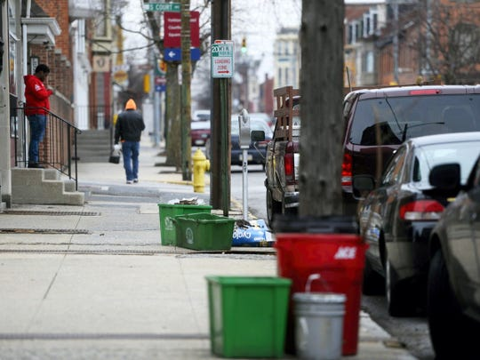 Recycle and trash bins sit on the curb of East King Street in York. What is put in those recycling bins is of great interest to the state of Pennsylvania.