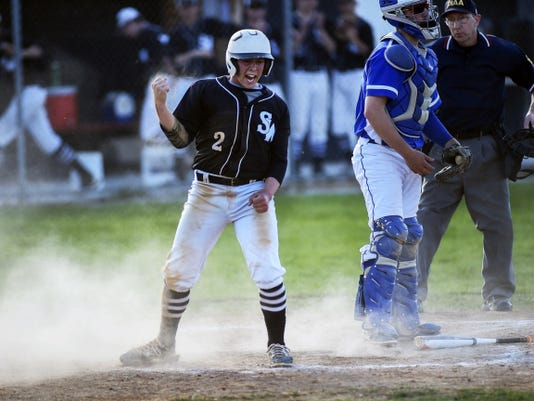 South Western's Kyle Raubenstine reacts after scoring the winning run for the Mustangs in the seventh inning during their 2-1 victory over Spring Grove on Wednesday at South Western High School. Raubenstine scored the run on a squeeze play. He also picked up the win on the pitcher's mound for the Mustangs.