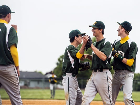 York Catholic's Jake Krevetski is congratulated by teammates after York Catholic defeated Delone Catholic, 2-1, in a District 3 Class AA baseball quarterfinal Thursday at Delone Catholic High School. The Fighting Irish will face Upper Dauphin in Tuesday's semifinals with a spot in the PIAA tournament on the line.