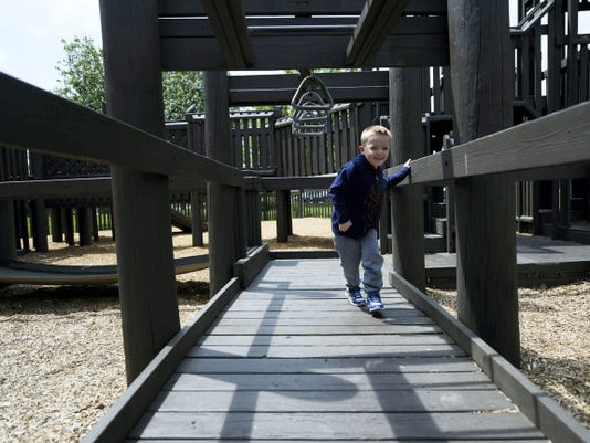 Dakota Dawson, 4, of York runs through the maze of wood at Springettsbury Township Park. The new equipment that will replace the wooden structure will be made of more durable materials and will be easier to maintain, said David Wendell, parks and recreation director for the township.