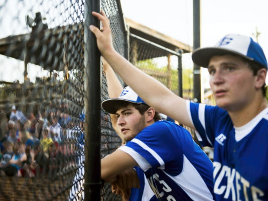 Spring Grove players watch as the Rockets run the bases during Tuesday's District 3 Class AAA semifinal against Twin Valley. Spring Grove won, 4-2, and will face Donegal in Thursday's title game for a chance to win the program's first district crown.