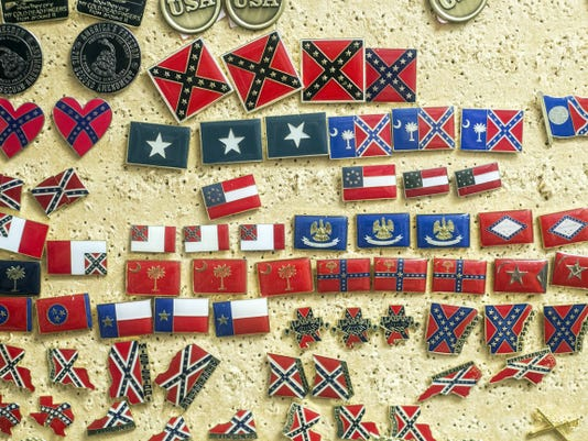 Flag pins in many shapes and sizes are displayed for sale at a Gettysburg store on Tuesday.