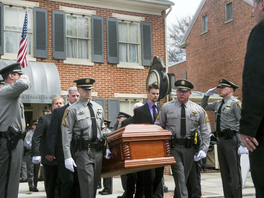 Members of the Hanover Borough Police Department carry the casket of former Hanover Chief of Police Randy Whitson after a funeral service on April 20.