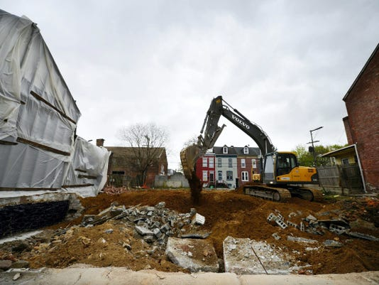 A demolition crew clears a three-parcel lot in the 200 block of East Walnut Street last month. Think Loud Development, which owns one of the parcels, expressed interest in donating its land to the city or a nonprofit group for a park. Officials with the city's Redevelopment Authority, owner of a second property, said they would be willing to do the same. A private citizen owns the third piece of the contiguous properties spanning 0.11 acres.