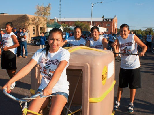 Headlight File Photo   Some of the more competitive and entertaining races are run by women during the Great American Outhouse Race. Pats racers are, from left, Yovanie Duran, J.J. Jasso, Kassy Loya and Elyssa Camarena.