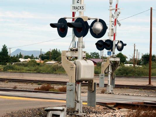 Bill Armendariz - Headlight Photo   The train crossing near Railroad Avenue and North Pearl Street.
