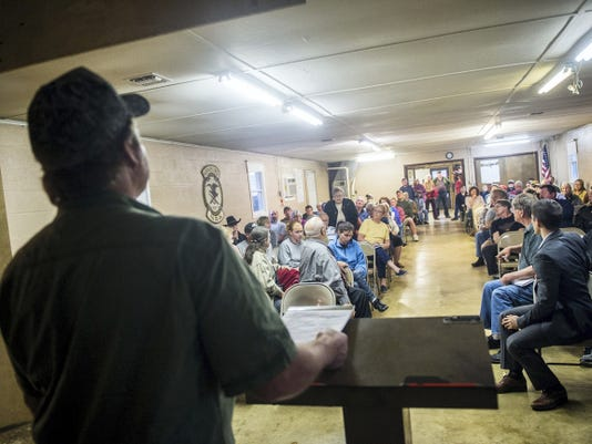 Speaker Brian Kaltreider moderates a question from the audience at a meeting about a proposed poultry farm and nearby feed mill in Codorus Township on April 19.