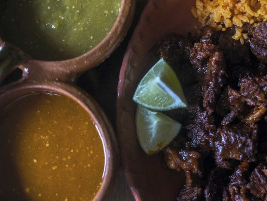 Birria is a dish made of beef, rice, beans and pico de gallo, a recipe passed down to Hugo Garcia from his grandmother to his father. (Clare Becker   FLIPSIDEPA)