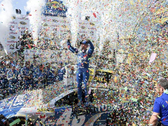 Jimmie Johnson celebrates in victory lane after winning Sunday's NASCAR Sprint Cup race at Dover International Speedway in Dover, Del. It was Johnson's 10th win at Dover.