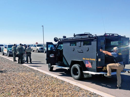 San Juan County Sheriff's Office deputies set up a command center on Thursday at Northern Edge Navajo Casino in Upper Fruitland.
