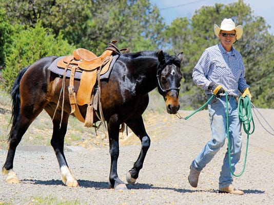 Born walks Tatanka to the larger arena for a training session.