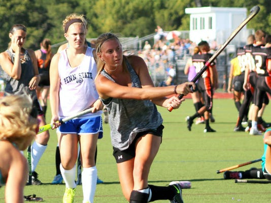 Central York's Greta Plapper takes a shot during field hockey practice Tuesday. The senior captain scored 10 goals and added 12 assists last season and looks to lead